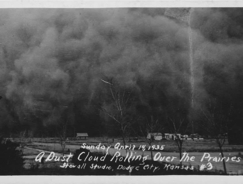 his is a photograph of a dust cloud rolling over the prairie near Hugoton, Kansas. Southwest Kansas was among the hardest hit areas during the Dust Bowl. Dust storms, such as the one depicted here, could blow for a full day, coating everything in their path with a layer of dirt. It was taken by the Stovall Studio in Dodge City, Kansas on Sunday April 14, 1935.